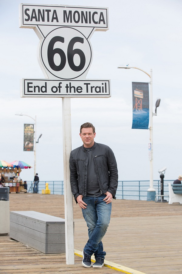 Host Tyler Florence opens up the show at the end of Route 66, in Santa Monica, California, as seen on Food Network's, The Great Food Truck Race, Season 6.