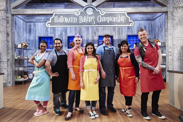 Competitors Ashlee Marier Prisbrey, Scott Breazale, Erin Cooper, Rudy Martinez, Jennifer Petty, Jason Hisley, and Audrey Alfaro, during the Main-Heat round, Trick or Treat, Classic Costume Desserts, as seen on Food Network's Halloween Baking Championship, Season 1.