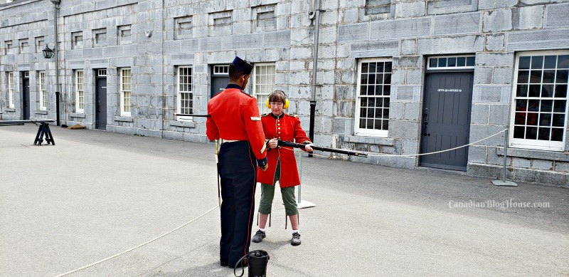 Firing a musket at Fort Henry in Historic Downtown Kingston