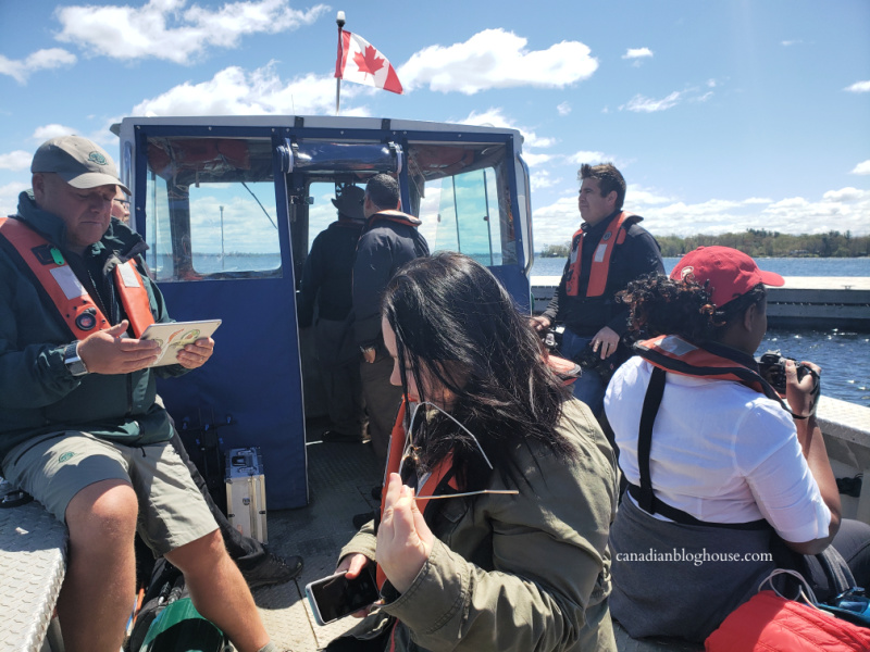 Parks Canada staff and Canadian writers on board a Parks Canada boat