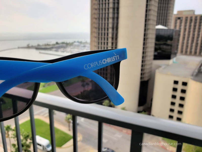 Corpus Christi sunglasses on balcony of Omni Hotel